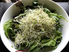 A handful of nutrient-dense sprouts over the mix.